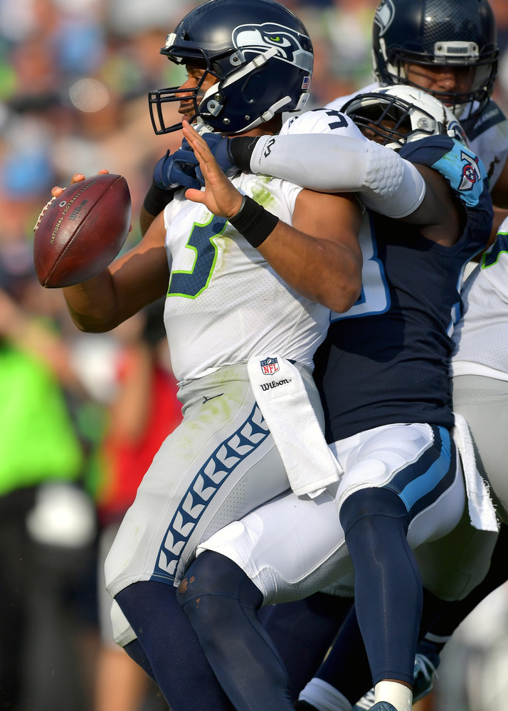 Seattle Seahawks quarterback Russell Wilson (3) is pressured by the Titans during the first half of the Seahawks at Tennessee Titans NFL football game on Sept. 24, 2017, at Nissan Stadium in Nashville, Tenn. (Photo by Lee Walls)