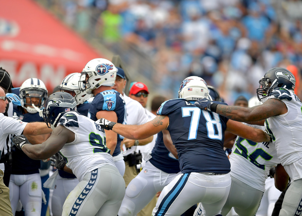 A fight breaks out on the Titans sideline following a late hit to Titans quarterback Marcus Mariota (8) in the first half of the Seattle Seahawks at Tennessee Titans NFL football game on Sept. 24, 2017, at Nissan Stadium in Nashville, Tenn. (Photo by Lee Walls)