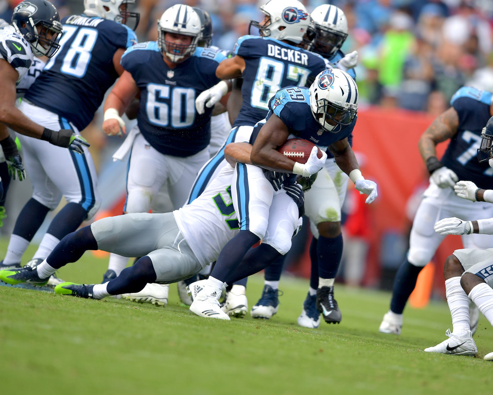 Running back DeMarco Murray (29) is tackled in the first half of the Seattle Seahawks at Tennessee Titans NFL football game on Sept. 24, 2017, at Nissan Stadium in Nashville, Tenn. (Photo by Lee Walls)