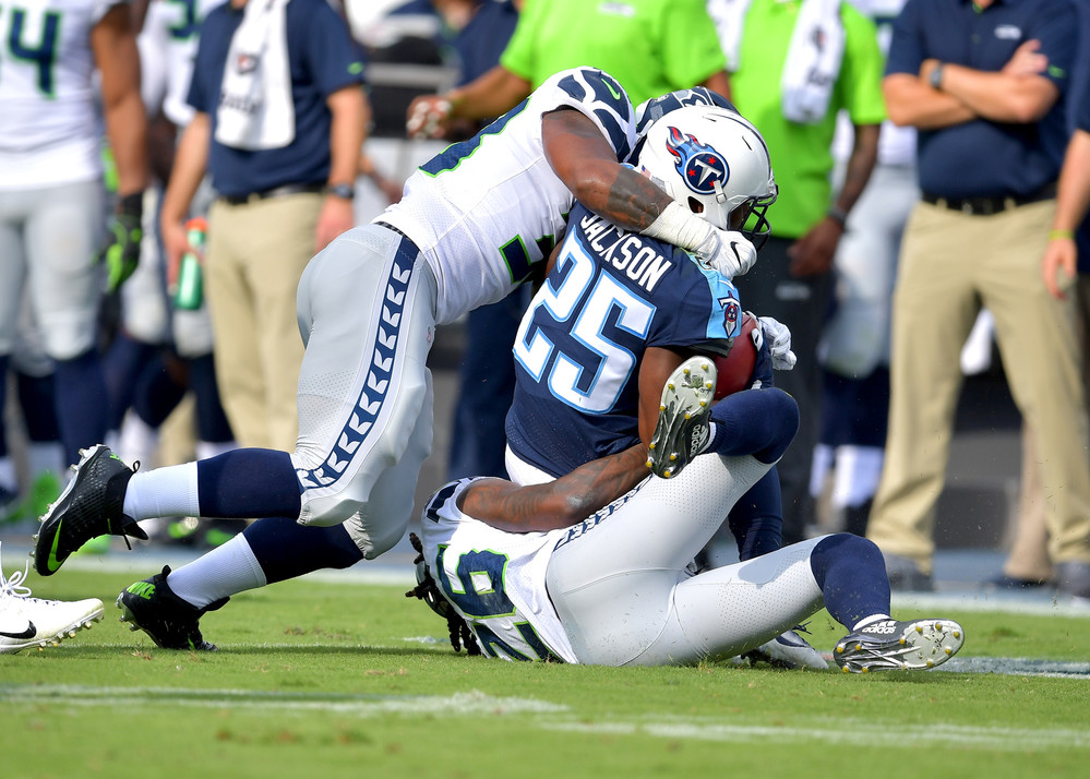 Tennessee Titans cornerback Adoree' Jackson (25) is tackled in the first half of the Seattle Seahawks at Titans NFL football game on Sept. 24, 2017, at Nissan Stadium in Nashville, Tenn. (Photo by Lee Walls)