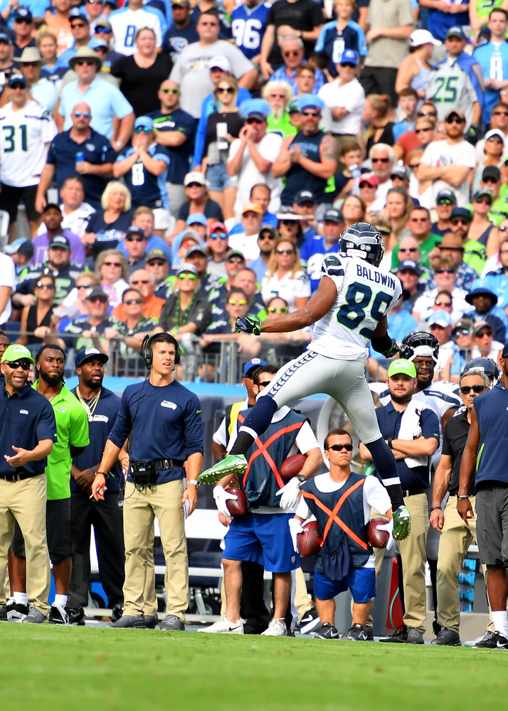 Seattle Seahawks wide receiver Doug Baldwin (89) gets tremendous height but can't make the catch in the first half of the Seahawks at Titans NFL football game on Sept. 24, 2017, at Nissan Stadium in Nashville, Tenn. (Photo by Lee Walls)