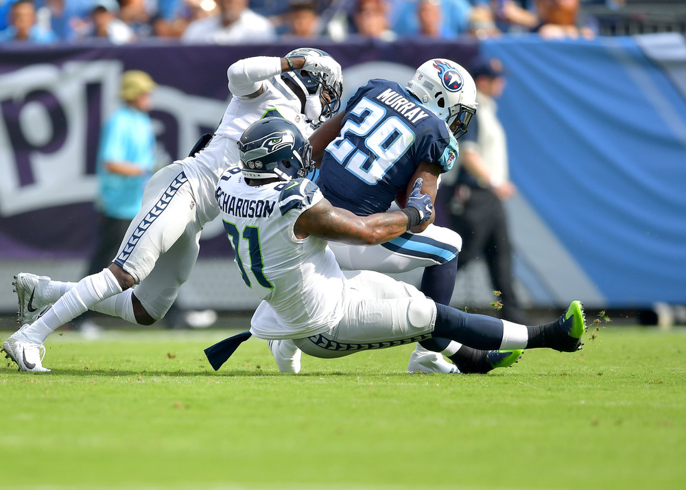 Titans running back DeMarco Murray (29) is tackled in the first half of the Seattle Seahawks at Tennessee Titans NFL football game on Sept. 24, 2017, at Nissan Stadium in Nashville, Tenn. (Photo by Lee Walls)
