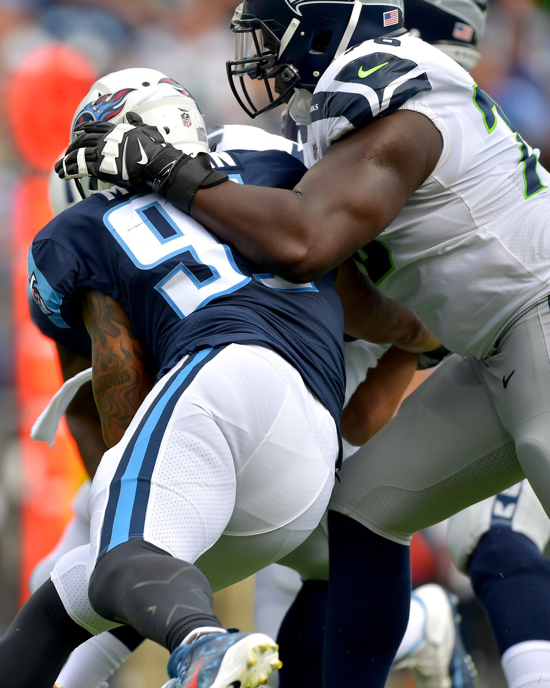 Tennessee Titans outside linebacker Derrick Morgan (91) in action during the first half of the Seattle Seahawks at Tennessee Titans NFL football game on Sept. 24, 2017, at Nissan Stadium in Nashville, Tenn. (Photo by Lee Walls)