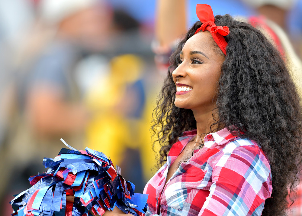 A Tennessee Titans cheerleader performs during the first half of the Seattle Seahawks at Tennessee Titans NFL football game on Sept. 24, 2017, at Nissan Stadium in Nashville, Tenn. (Photo by Lee Walls)