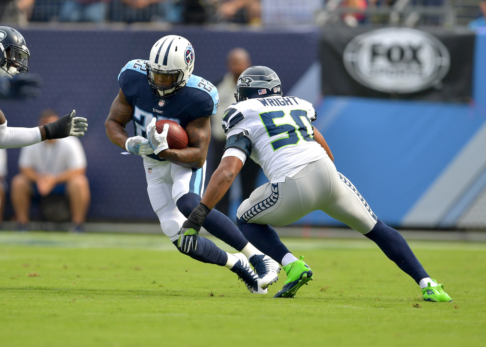 Tennessee Titans running back Derrick Henry (22) tries to evade Seattle Seahawks outside linebacker K.J. Wright (50) in the first half of the Seattle Seahawks at Titans NFL football game on Sept. 24, 2017, at Nissan Stadium in Nashville, Tenn. (Photo by Lee Walls)