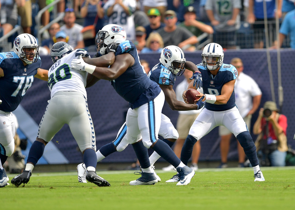 Tennessee Titans quarterback Marcus Mariota (8) hands off the ball to Taywan Taylor (13) during the first half of the Seattle Seahawks at Titans NFL football game on Sept. 24, 2017, at Nissan Stadium in Nashville, Tenn. (Photo by Lee Walls)