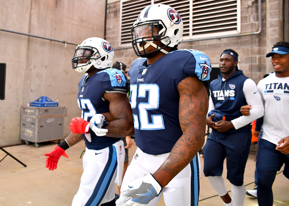 Titans players enter the field after the national anthem with interlocked arms prior to the first half of the Seattle Seahawks at Tennessee Titans NFL football game on Sept. 24, 2017, at Nissan Stadium in Nashville, Tenn. (Photo by Lee Walls)
