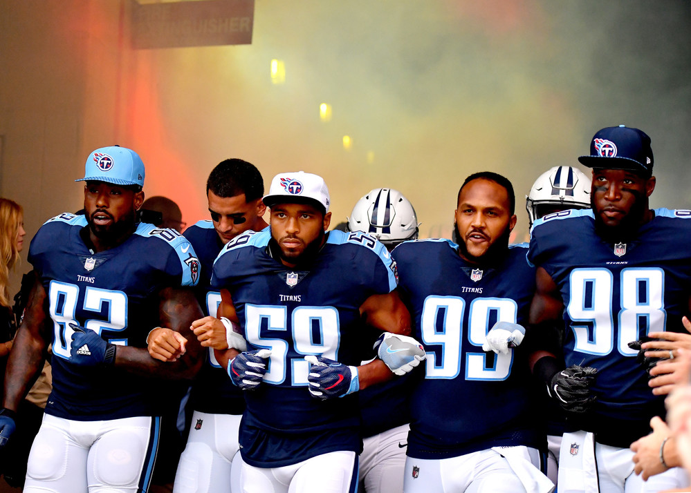Tennessee Titans tight end Delanie Walker (82), linebacker Wesley Woodyard (59), defensive end Jurrell Casey (99), and outside linebacker Brian Orakpo enter the field with interlocked arms in a show of unity prior to the first half of the Seattle Seahawks at Tennessee Titans NFL football game on Sept. 24, 2017, at Nissan Stadium in Nashville, Tenn. (Photo by Lee Walls)