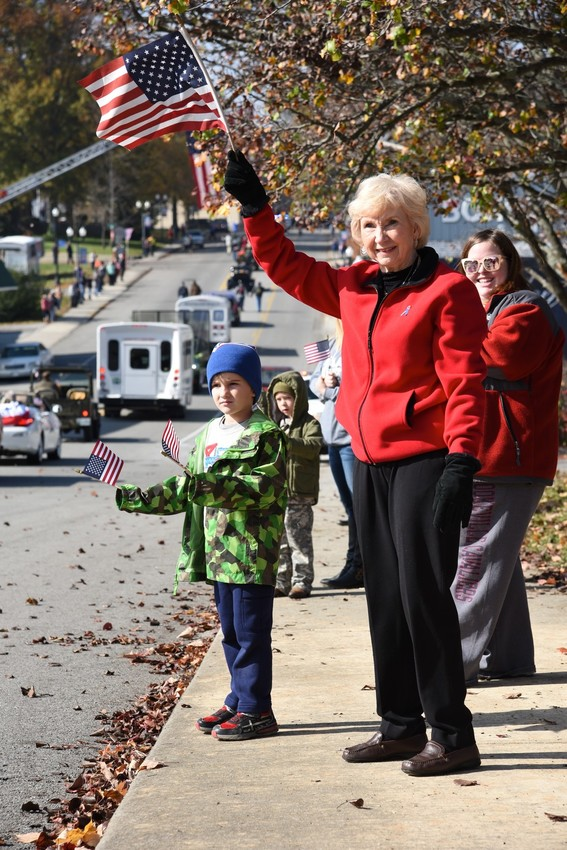 Bobbie Wyatt, 73, and Jasper Bray, the four-year-old son of Wesley and Ashley Bray, all of Cookeville, recognize all veterans by waiving their American Flags during the Cookeville Veterans Parade Friday.