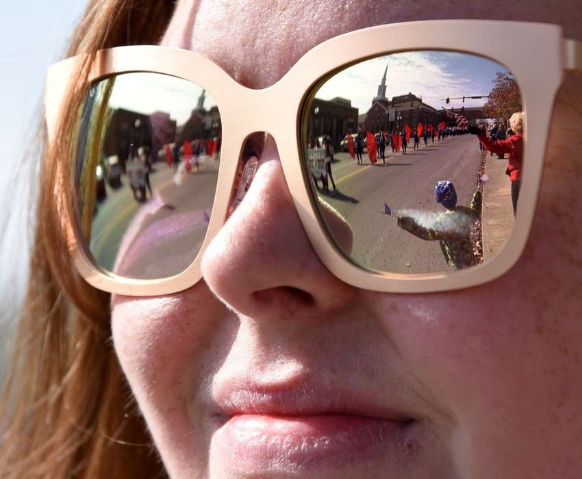 The annual Cookeville Veterans Day Parade is reflected in the sunglasses of 27-year-old Rachel Craighead of Cookeville.