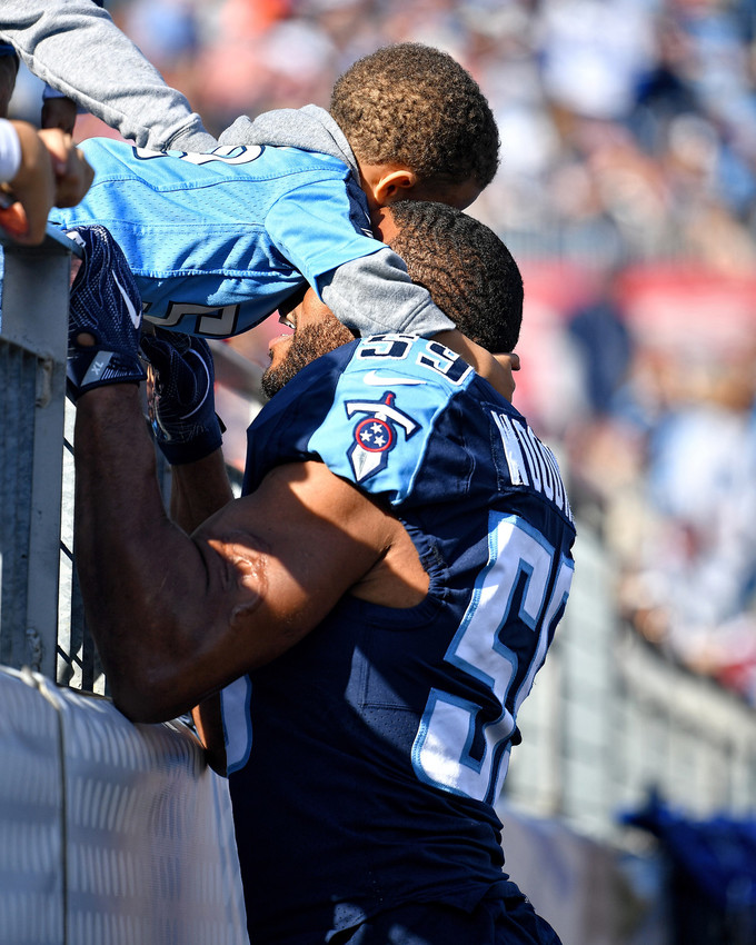 Tennessee Titans inside linebacker Wesley Woodyard (59) gets a pre-game hug before the first half of the NFL football game between the Titans and the Houston Texans on Dec. 3, 2017, at Nissan Stadium in Nashville, Tenn. The Titans won 24-13. (Photo by Lee Walls)