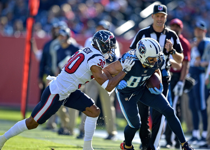 Tennessee Titans wide receiver Eric Decker (87) gets shoved out of bounds after a catch during the first half against the Houston Texans on Dec. 3, 2017, at Nissan Stadium in Nashville, Tenn. The Titans won 24-13. (Photo by Lee Walls)