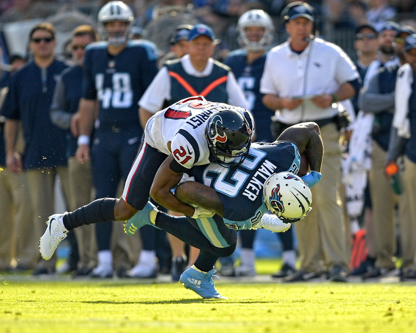 Tennessee Titans tight end Delanie Walker (82) is tackled after a catch in the first half of the NFL football game between the Titans and the Houston Texans on Dec. 3, 2017, at Nissan Stadium in Nashville, Tenn. The Titans won 24-13. (Photo by Lee Walls)