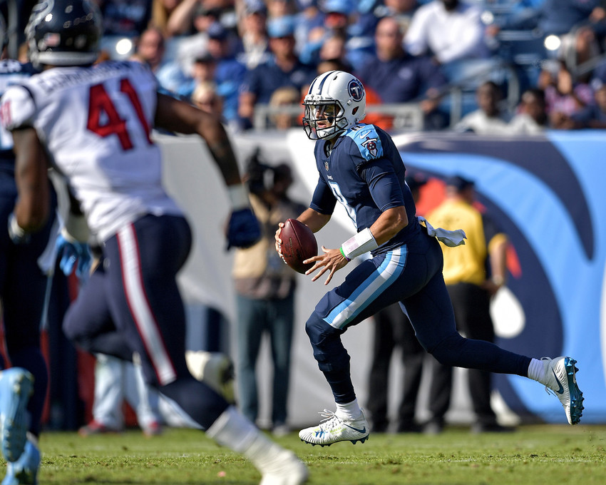 Tennessee Titans quarterback Marcus Mariota (8) looks for a receiver in the first half of the NFL football game between the Titans and the Houston Texans on Dec. 3, 2017, at Nissan Stadium in Nashville, Tenn. The Titans won 24-13. (Photo by Lee Walls)