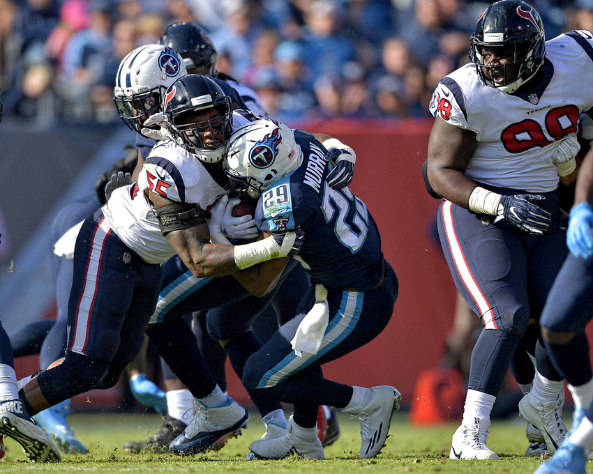 Tennessee Titans running back DeMarco Murray (29) is tackled in the first half against the Houston Texans on Dec. 3, 2017, at Nissan Stadium in Nashville, Tenn. The Titans won 24-13. (Photo by Lee Walls)