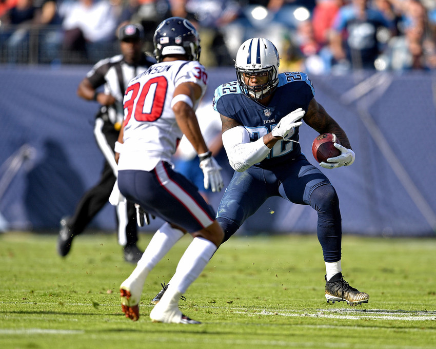 Tennessee Titans running back Derrick Henry (22) acts as a receiver and adds yards after the catch in the first half against the Houston Texans on Dec. 3, 2017, at Nissan Stadium in Nashville, Tenn. The Titans won 24-13. (Photo by Lee Walls)
