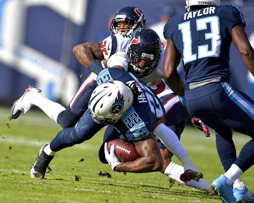 Tennessee Titans running back Derrick Henry (22) is tackled after a long run in the first half against the Houston Texans on Dec. 3, 2017, at Nissan Stadium in Nashville, Tenn. The Titans won 24-13. (Photo by Lee Walls)
