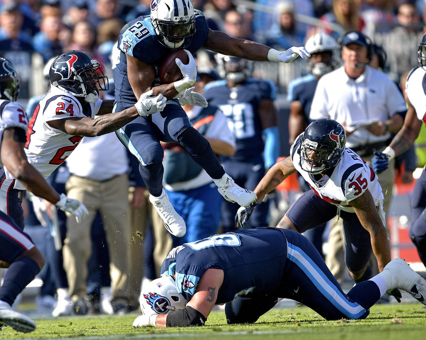 Tennessee Titans running back DeMarco Murray (29) leaps during a run in the first half of the game against the Houston Texans on Dec. 3, 2017, at Nissan Stadium in Nashville, Tenn. The Titans won 24-13. (Photo by Lee Walls)