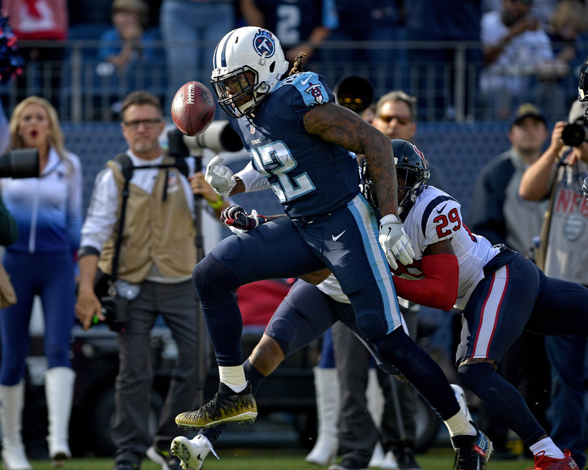 Tennessee Titans running back Derrick Henry (22) has the ball knocked out of his hands during the first half of the game against the Houston Texans on Dec. 3, 2017, at Nissan Stadium in Nashville, Tenn. The Titans won 24-13. (Photo by Lee Walls)