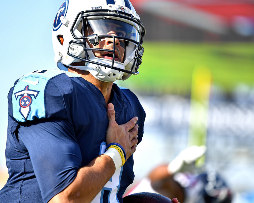 Tennessee Titans quarterback Marcus Mariota (8) with a quarterback keeper for a touchdown in the first half of the NFL football game against the Houston Texans on Dec. 3, 2017, at Nissan Stadium in Nashville, Tenn. The Titans won 24-13. (Photo by Lee Walls)