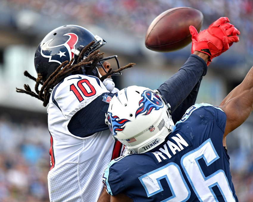 Tennessee Titans cornerback Logan Ryan (26) breaks up a pass intended for Houston Texans wide receiver DeAndre Hopkins (10) in the second half of the game against the Houston Texans on Dec. 3, 2017, at Nissan Stadium in Nashville, Tenn. The Titans won 24-13. (Photo by Lee Walls)