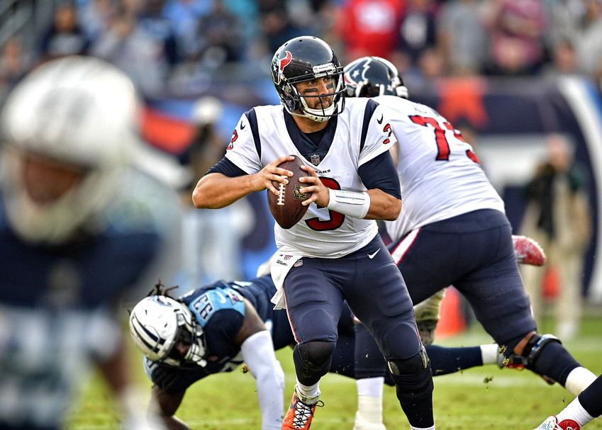 Houston Texans quarterback Tom Savage (3) scrambles under pressure in the second half of the NFL football game against the Houston Texans on Dec. 3, 2017, at Nissan Stadium in Nashville, Tenn. The Titans won 24-13. (Photo by Lee Walls)