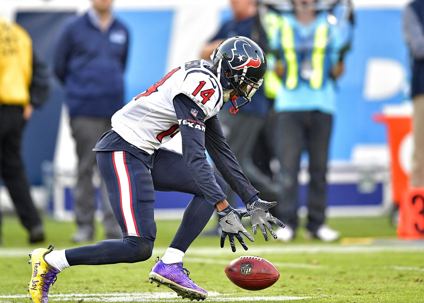 Houston Texans Chris Thompson (14) drops a catch during a kickoff in the second half of the NFL football game between the Tennessee Titans and the Texans on Dec. 3, 2017, at Nissan Stadium in Nashville, Tenn. The Titans won 24-13. (Photo by Lee Walls)