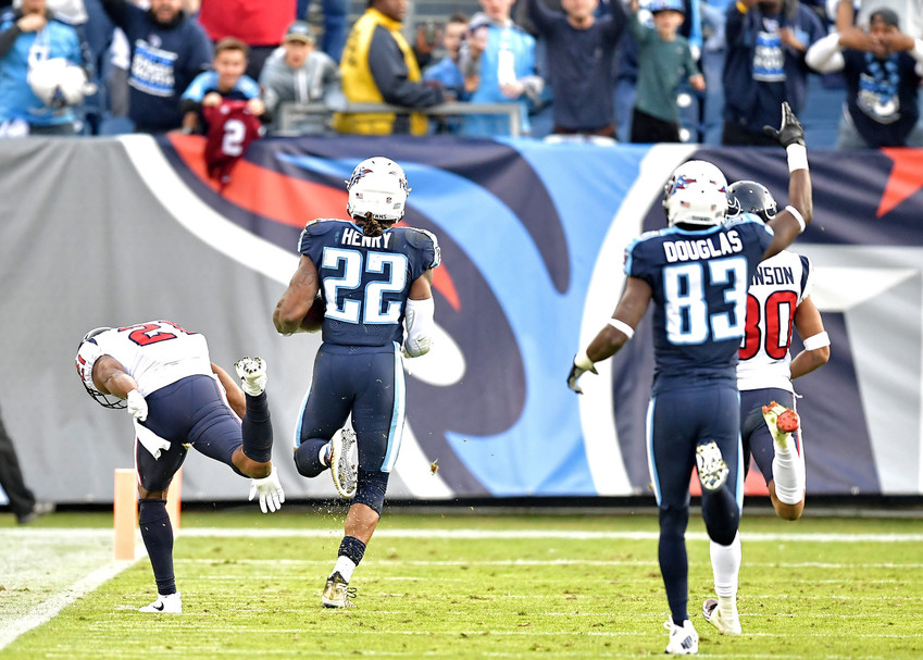 Tennessee Titans running back Derrick Henry (22) on a 75-yard touchdown run with less than a minute to play in the game against the Houston Texan on Dec. 3, 2017, at Nissan Stadium in Nashville, Tenn.  The Titans won 24-13. (Photo by Lee Walls)