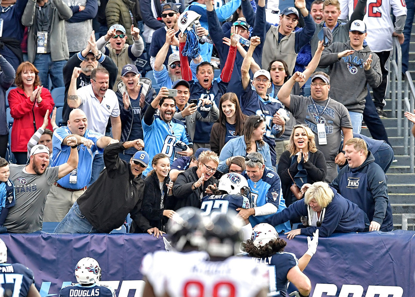 Tennessee Titans running back Derrick Henry (22) celebrates with fans his 75-yard touchdown run with less than a minute to play in the game against the Houston Texan on Dec. 3, 2017, at Nissan Stadium in Nashville, Tenn.  The Titans won 24-13. (Photo by Lee Walls)