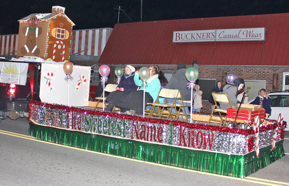 "Hope in Christ Fellowship's float, titled ""Jesus, the Sweetest Name I Know,"" features a gingerbread house during the Monterey Christmas parade."