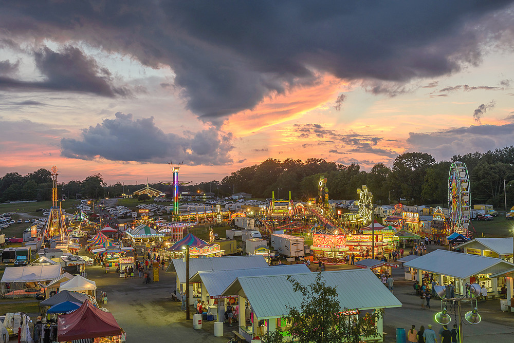 The Putnam County Fair glows at sunset. It placed first in the Putnam County Fair category and Best in Show in the Professional division of this year's fair photography competition.. \rOriginal Caption:.Bill Miller placed first in the Putnam County Fair category and Best in Show in the Professional division.