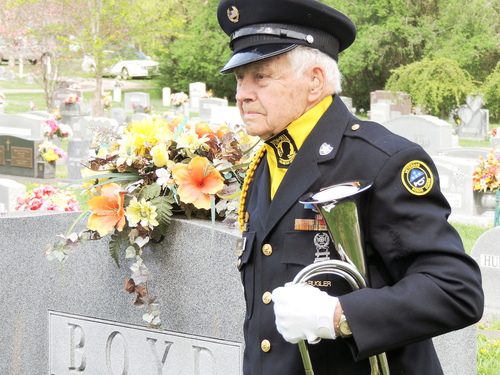 Lehman Riggs, 95, bugler for the Veterans Honor Guard, awaits his cue to play Taps at a fellow soldier's funeral.