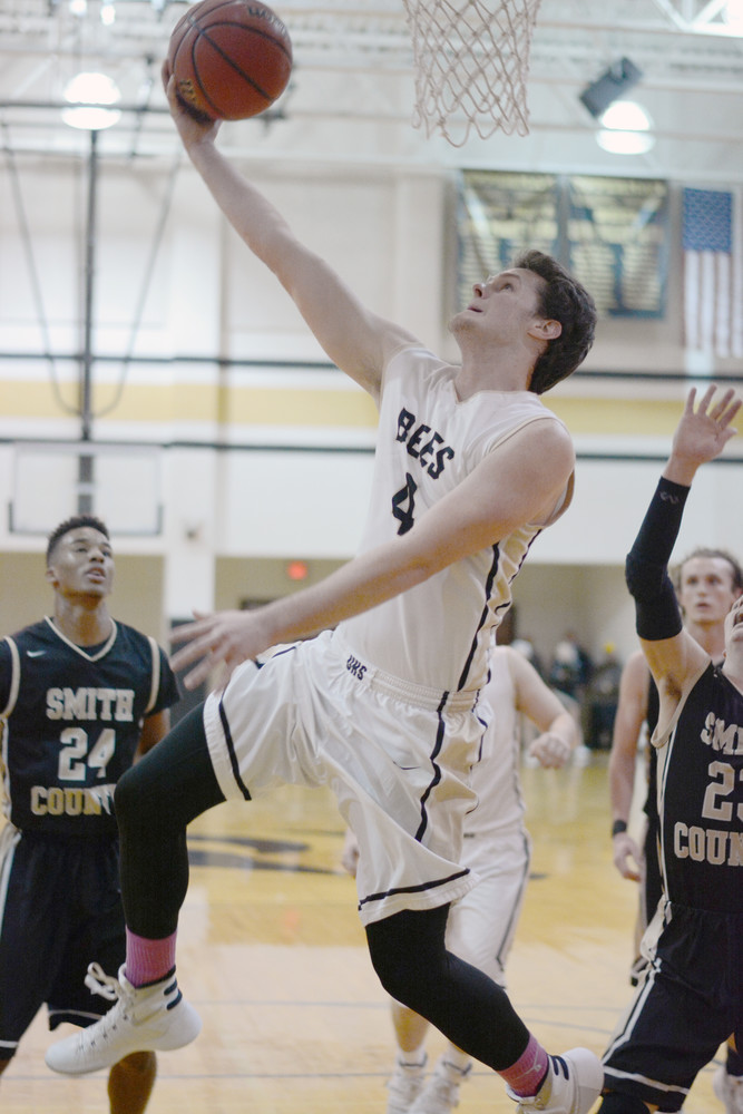 Upperman's Austin Shrum soars to the basket during the Bees 69-33 ...