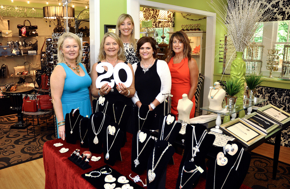 Celebrating 20 years of business last September at JJ Jax, from left, are Jax girl Lisa Parker, owner Jenny Jackson Spurlock, and Jax Girls Abby Holland, Judy Myers and Renae Hayes. Spurlock is closing her store to pursue a new opportunity with the Chamber.. \rOriginal Caption:Ty Kernea | Herald-Citizen.Celebrating 20 years of business at JJ Jax, from left, are Jax girl Lisa Parker, owner Jenny Jackson Spurlock, and Jax Girls Abby Holland, Judy Myers and Renae Hayes.