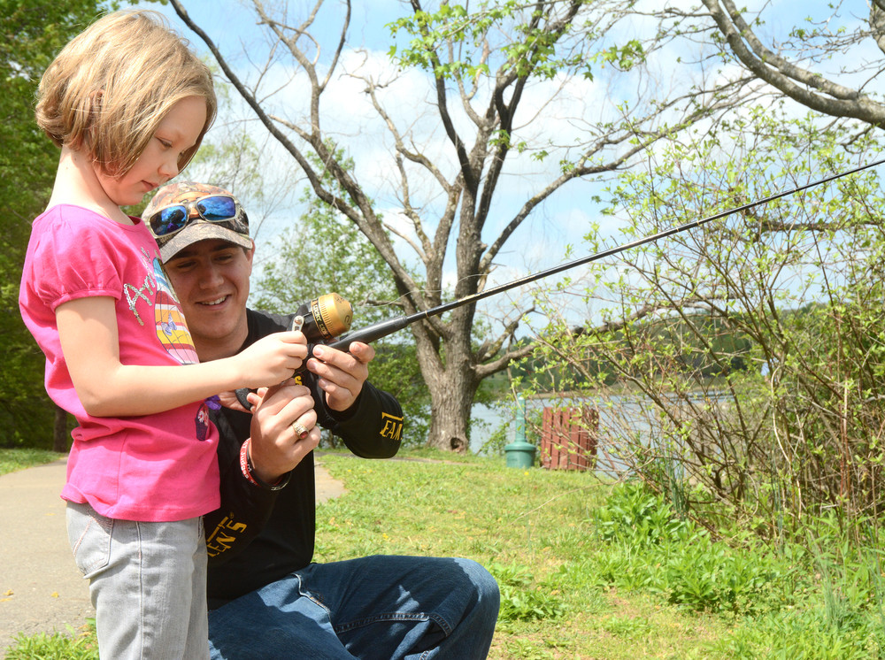 Ethan Cole, fishing instructor, gives seven-year-old Karly Tylka some pointers during this year's Nature Fest. The event brought experts into town to give presentations and teach nature-related skills to adults and children.
