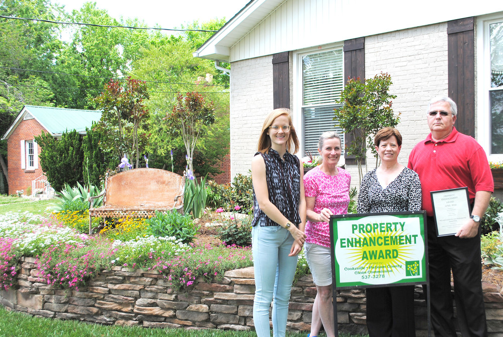 The Brown family was the winner of this month's Property Enhancement Award for their home on East Hudgens Street in Cookeville. Celebrating are, from left, Linday Mills, Keep Putnam County Beautiful Clean Commission board member; Shannon Reese, Clean Commission executive director; and homeowners Vickie and Ray Brown.