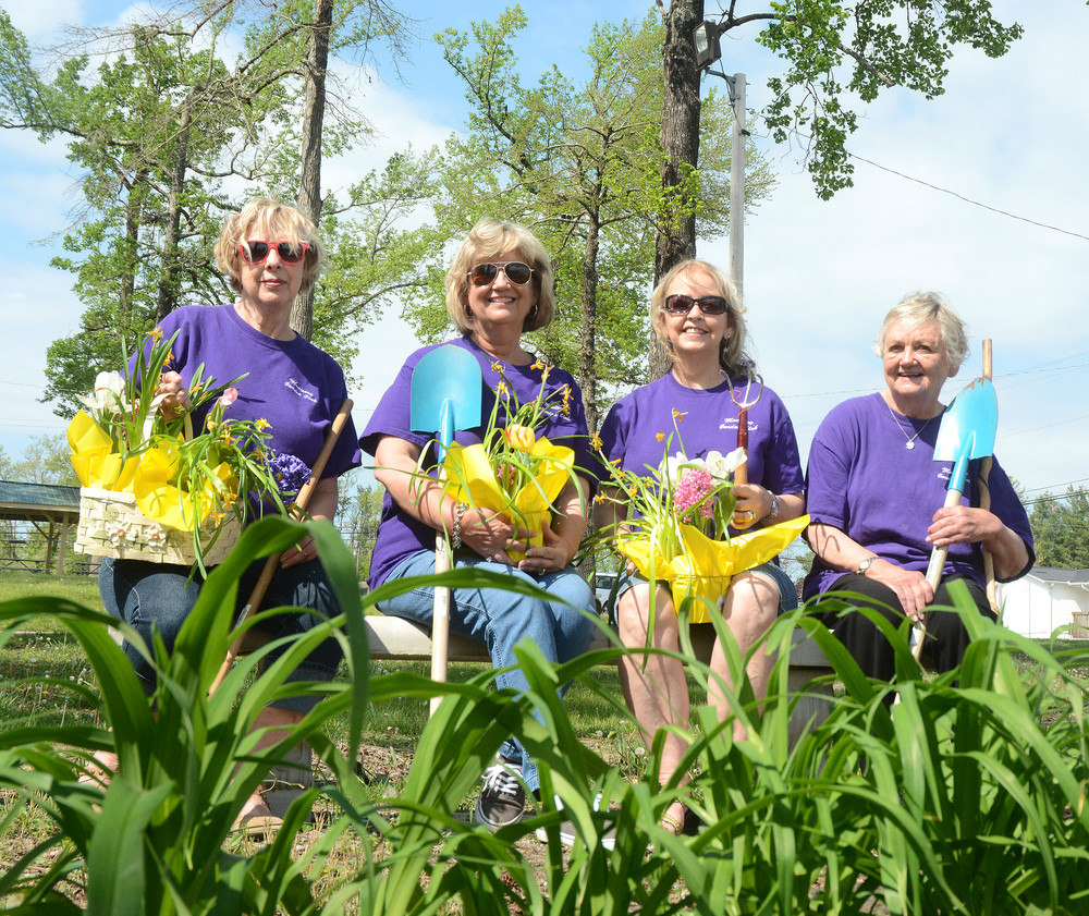 Monterey Garden Club members, from left, Linda Jensen, president; Janice Boswell, member; Patt Judd, vice president; and Louise Vail, treasurer; prepare for the club's annual plant sale coming up May 7 at Monterey Farmer's Market during the town's Spring on the Mountain festival, which is from 9 a.m. to 2 p.m.