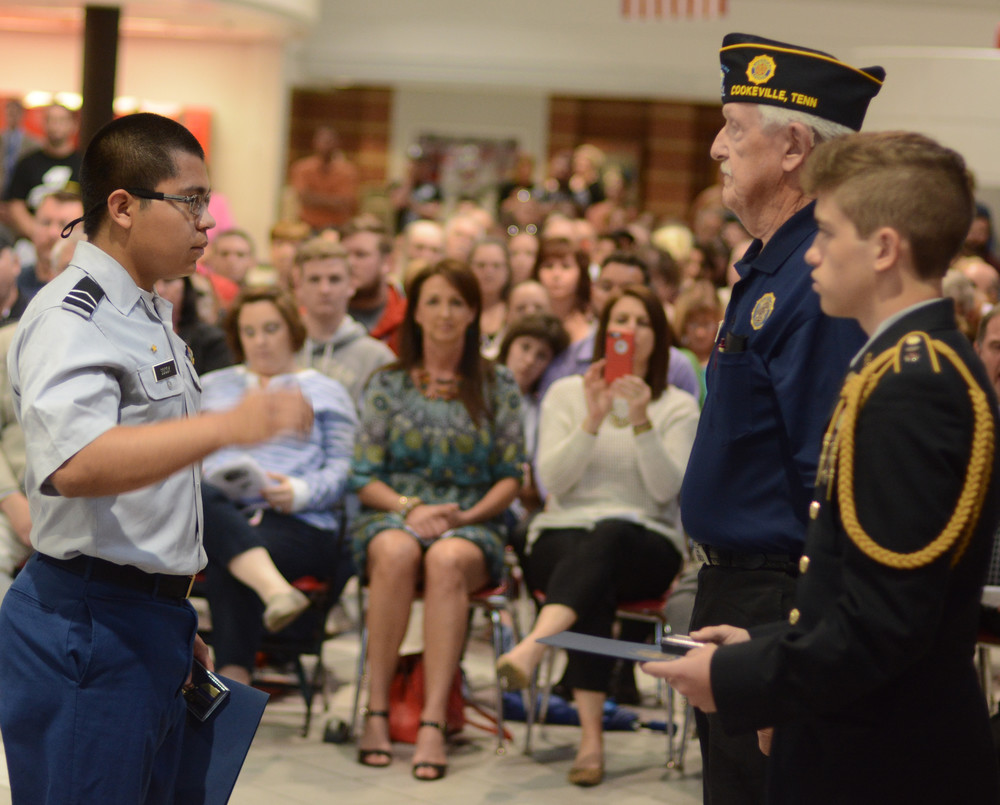 JROTC Cadet Staff Sgt. Jerry Socoy, left, receives the American Legion Scholastic Excellence Award from Gus Rich.