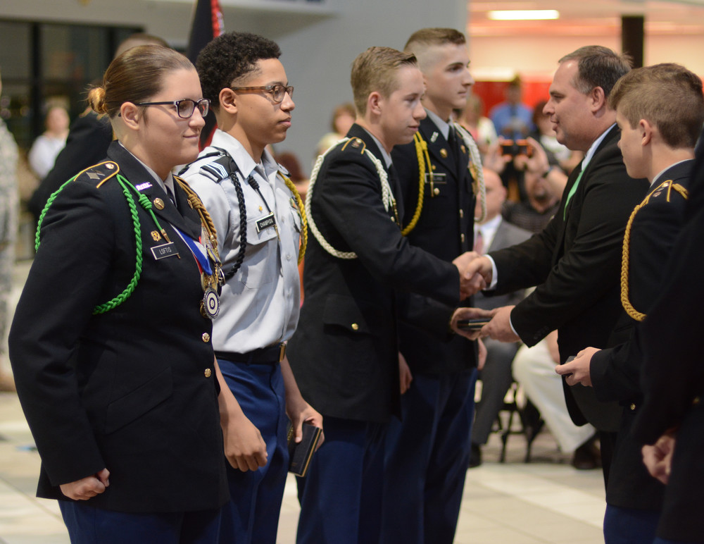 JROTC Superior Cadet awards for the spring, presented by Cookeville High School Principal Lane Ward, right, go to, from left, CHS students Cadet Lt. Col. Kayla Loftis, Cadet Staff Sgt. Nathan Champion, Cadet Cpt. Michael Bregenzer and Cadet Cpt. Logan England.