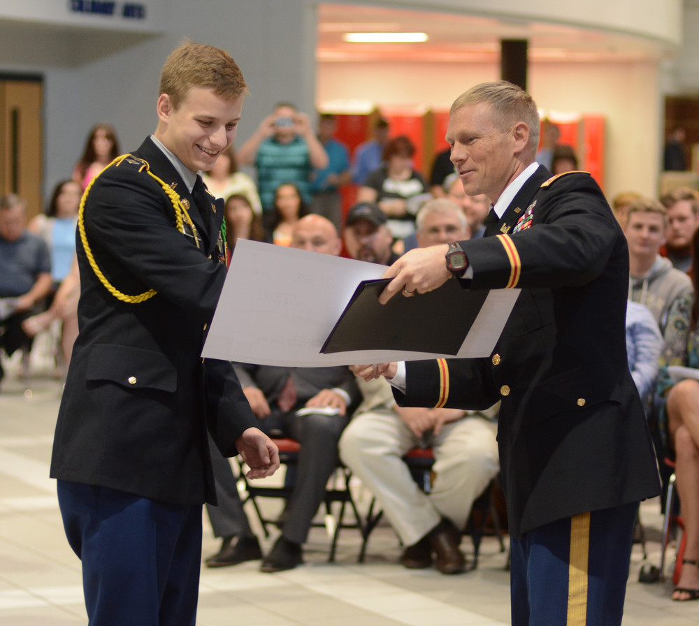 JROTC Cadet Lt. Col. Rutger Reiser of Cookeville High School receives the Tennesee Tech University STEM and ROTC scholarship award from Lt. Col. Steven Peterson. Rieser was also the recipent of the Sergeant Alex Van Aalten Scholarship.