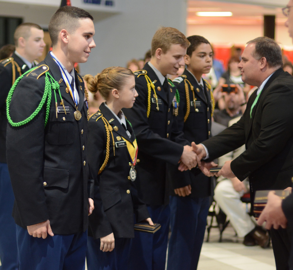 Cookeville High School Principal Lane Ward, right, presents JROTC Superior Cadet awards for the fall to CHS students, from left, Cadet Major Harmon Wattenbarger, Cadet Cpt. Lainee Darrow, Cadet Lt. Col. Rutger Reiser and Cadet Staff Sgt. Gabriel Lamberson.