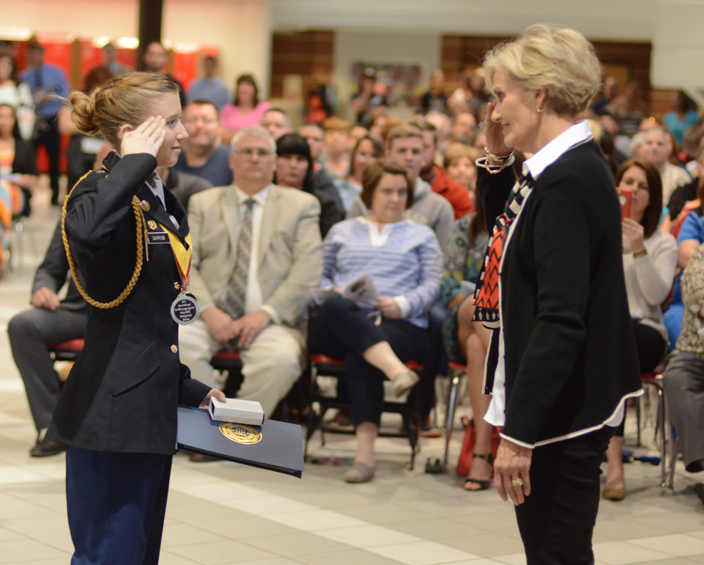 JROTC Cadet Cpt. Lainee Darrow, left, receives the Upper Cumberland chapter of the Military Officers Association of American award from retired Lt. Col. Wendy Bottomley.