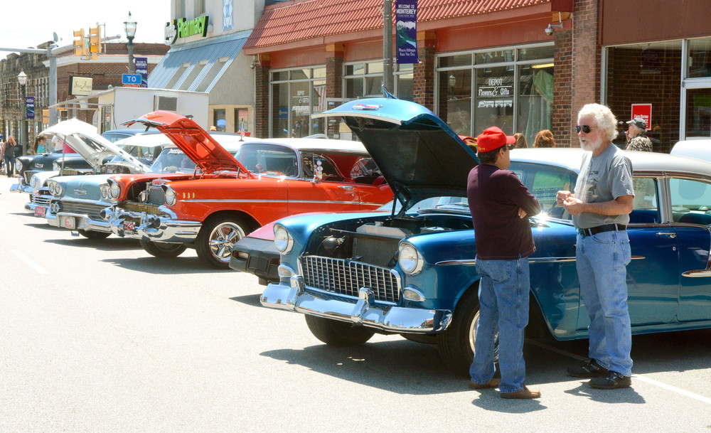 Frank Casale, left, talks to Dennis Griffiths, owner of the 1955 Chevy, at the car show during the festival.