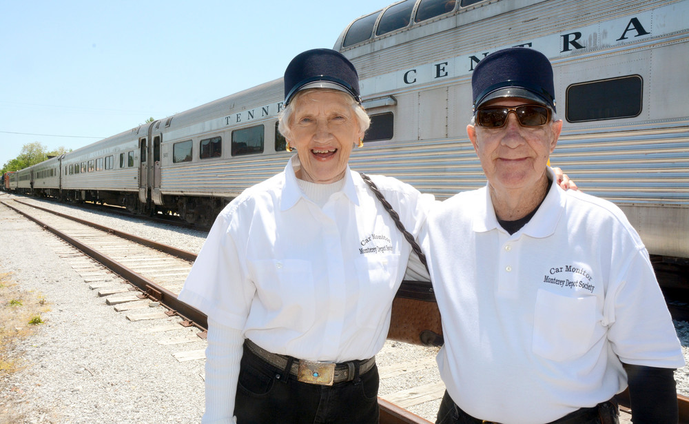 Sue and Bill Eldridge, Monterey Depot car monitors, pause from monitoring one of the train cars that pulled into Monterey during the festival.