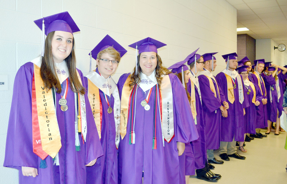 Leading the way while they and their fellow classmates line up before graduation Saturday evening at Monterey High School are, from left, Macey Davis, valedictorian; Brendon Wood, salutatorian; and Emily Bartlett, third honor.