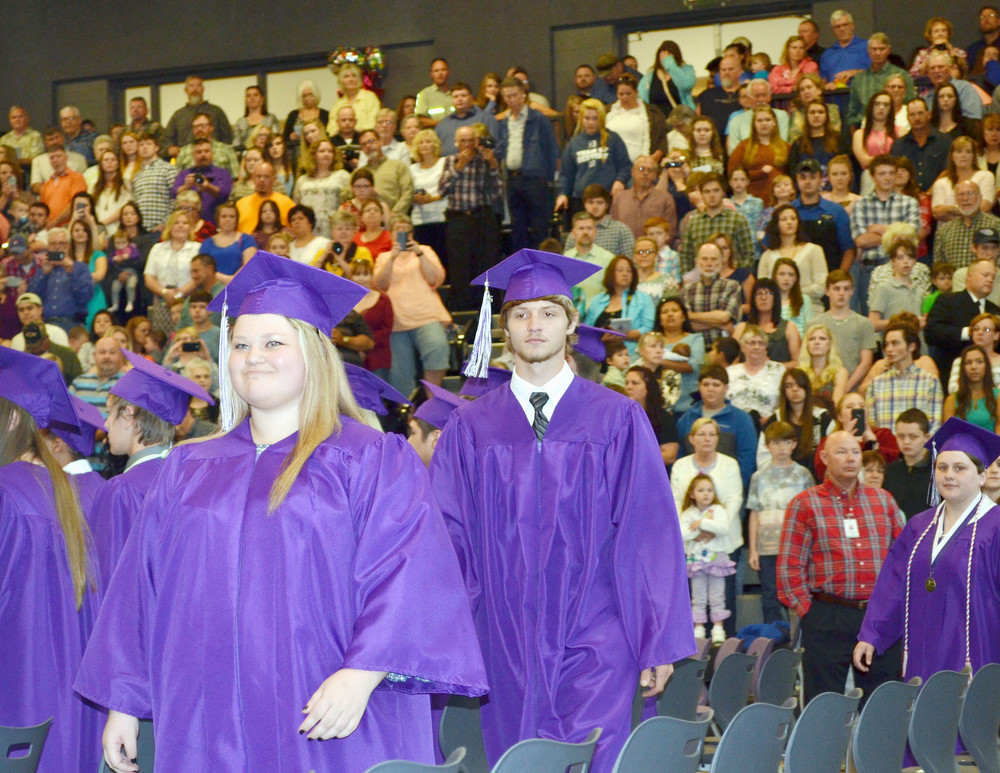 Monterey High School graduates Britney Murphy and Dalton Murphy file into the MHS gym for their Saturday evening commencement ceremony. The 92-member Class of 2016 was the first to graduate from the new high school, and the gym was filled to capacity for the occasion. See more photos on Page 8. .