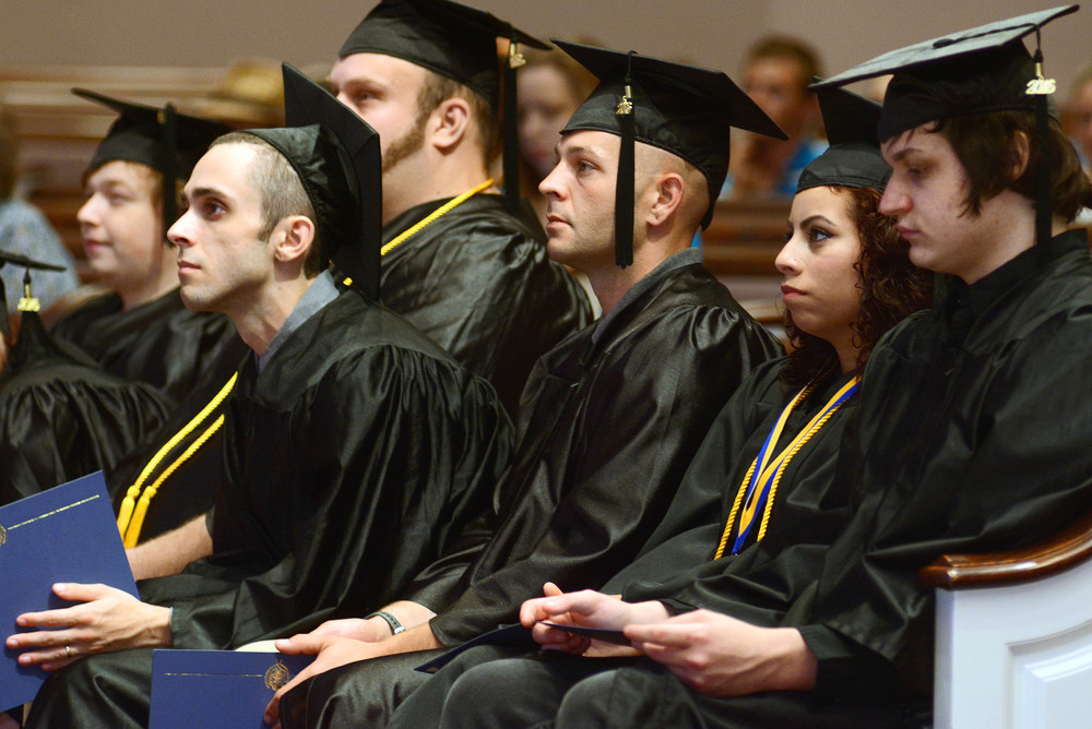 Graduates of Putnam County Adult Education listen to keynote speaker Senator Paul Bailey. From left, are Brandon Banks, Stephen Colon, David Bryant, Allen Cool, Diana Gaspar and Blake Goolsby.