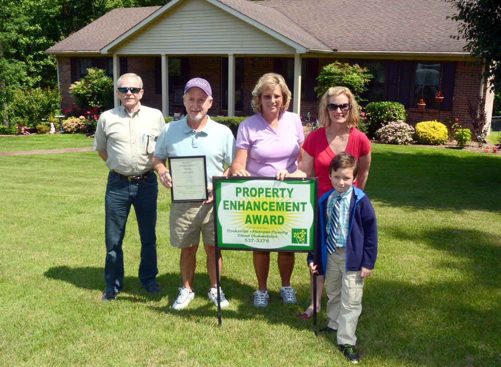The Fielder family was the winner of a Property Enhancement Award from the Keep Putnam County Beautiful Clean Commission. for their home on Apple Valley Drive in Cookeville. Celebrating are, from left, Keith Street, Clean Commission Board member; Bill and Trish Fielder, home owners; and Shannon Reese, executive director, and her son Yoel Reese.
