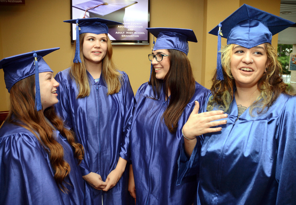 Students of the Adult High School nervously wait for their graduation to begin so they can accept their diplomas and become official graduates. From left are Taylor Warren, Stephanie Shrum, Lauren Kilgore and Katherine Smith.