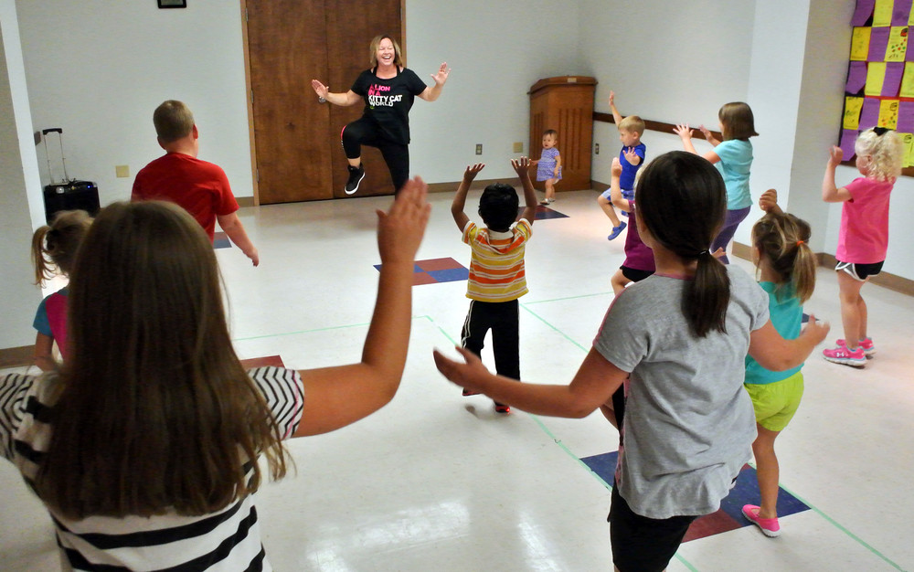 Zumba instructor Emily Loy keeps kids moving during the Putnam County Library's summer reading program.